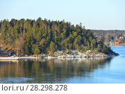 Купить «Stockholm archipelago, largest archipelago in Sweden, and second-largest archipelago in Baltic Sea. Archipelago extends from Stockholm roughly 60 kilometres (37 mi) to east. March», фото № 28298278, снято 27 марта 2018 г. (c) Валерия Попова / Фотобанк Лори