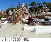 Купить «Детский городок Lost City с развлечениями для маленьких. Аквапарк Сиам, Коста-Адехе, Тенерифе, Канары, Испания», фото № 28304482, снято 29 декабря 2015 г. (c) Кекяляйнен Андрей / Фотобанк Лори