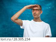 Купить «Cute man posing on blue background», фото № 28305234, снято 6 декабря 2017 г. (c) Pavel Biryukov / Фотобанк Лори