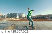 Купить «Adult skateboarder failed tricks outdoors in sunny day», видеоролик № 28307062, снято 19 апреля 2018 г. (c) Константин Шишкин / Фотобанк Лори