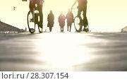 Купить «Young people walking outdoors and cyclists in sunny day», видеоролик № 28307154, снято 25 апреля 2018 г. (c) Константин Шишкин / Фотобанк Лори