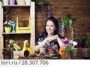 Купить «Woman is engaged in planting flowers», фото № 28307706, снято 14 апреля 2018 г. (c) Типляшина Евгения / Фотобанк Лори