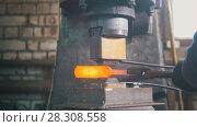 Купить «Blacksmith with hammer in forge creating steel knife», фото № 28308558, снято 29 февраля 2020 г. (c) Константин Шишкин / Фотобанк Лори