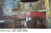 Купить «The blacksmith manually forging in the smithy», фото № 28308566, снято 17 июля 2018 г. (c) Константин Шишкин / Фотобанк Лори
