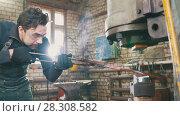 Купить «Man blacksmith in workshop forging red hot iron on anvil - small business», фото № 28308582, снято 17 июля 2018 г. (c) Константин Шишкин / Фотобанк Лори