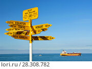 Купить «Global signpost - world distances measured from the world's southernmost signpost in Bluff, New Zealand», фото № 28308782, снято 26 апреля 2018 г. (c) BE&W Photo / Фотобанк Лори