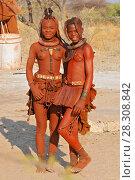 Купить «Two young Himba sisters near Kaokoland, Kunene, Namibia», фото № 28308842, снято 27 марта 2019 г. (c) BE&W Photo / Фотобанк Лори