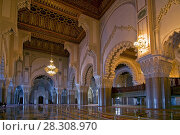 Купить «Arabic arches and ornaments in the interior of the Hassan II mosque in Casablanca, Morocco», фото № 28308970, снято 22 мая 2018 г. (c) BE&W Photo / Фотобанк Лори