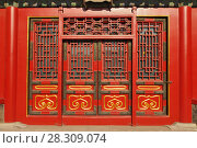 Купить «Traditional Chinese doors in The Palace Museum (Forbidden City) located in Beijing, China», фото № 28309074, снято 16 июля 2019 г. (c) BE&W Photo / Фотобанк Лори