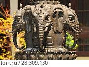 Купить «Close up of elephant statue in the courtyard of the Jade Buddha temple in Shanghai, China», фото № 28309130, снято 24 мая 2018 г. (c) BE&W Photo / Фотобанк Лори