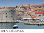 Купить «Aerial view of the walled city of Dubrovnik surrounded by the calm waters of the Adriatic Sea, Croatia», фото № 28309306, снято 17 октября 2018 г. (c) BE&W Photo / Фотобанк Лори