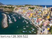 Купить «A view of the brightly coloured town of Corricella Procida, in the Bay of Naples, Italy», фото № 28309522, снято 21 марта 2019 г. (c) BE&W Photo / Фотобанк Лори