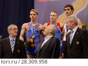 Купить «Flavius Koczi, Румыния, слева, Денис Аблязин, Россия, в центре, и Артур Давтян, Армения выиграли медали в опорном прыжке на Чемпионате Европы по спортивной гимнастике», фото № 28309958, снято 21 апреля 2013 г. (c) Stockphoto / Фотобанк Лори