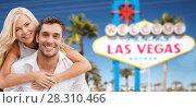 Купить «couple in shades over las vegas sign at summer», фото № 28310466, снято 14 июля 2013 г. (c) Syda Productions / Фотобанк Лори