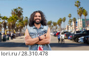 Купить «hippie man in demin vest at venice beach in la», фото № 28310478, снято 27 августа 2015 г. (c) Syda Productions / Фотобанк Лори