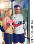 Купить «smiling young woman with personal trainer in gym», фото № 28310482, снято 29 июня 2014 г. (c) Syda Productions / Фотобанк Лори