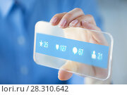 Купить «hand with social media icons on smartphone», фото № 28310642, снято 13 августа 2015 г. (c) Syda Productions / Фотобанк Лори