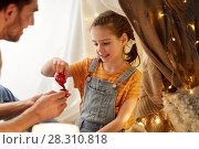 Купить «family playing tea party in kids tent at home», фото № 28310818, снято 27 января 2018 г. (c) Syda Productions / Фотобанк Лори