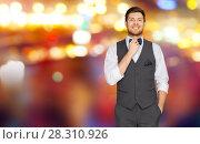 Купить «man in festive suit over night city lights», фото № 28310926, снято 15 декабря 2017 г. (c) Syda Productions / Фотобанк Лори
