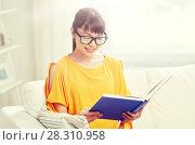 Купить «smiling young asian woman reading book at home», фото № 28310958, снято 9 марта 2016 г. (c) Syda Productions / Фотобанк Лори