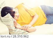 Купить «happy asian teenage girl sleeping on sofa at home», фото № 28310962, снято 9 марта 2016 г. (c) Syda Productions / Фотобанк Лори