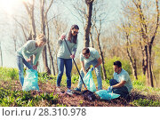 Купить «volunteers with garbage bags cleaning park area», фото № 28310978, снято 7 мая 2016 г. (c) Syda Productions / Фотобанк Лори