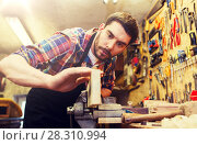 Купить «carpenter working with plane and wood at workshop», фото № 28310994, снято 14 мая 2016 г. (c) Syda Productions / Фотобанк Лори