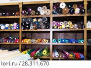Купить «different fabric bolts exposed on shelves», фото № 28311670, снято 2 марта 2018 г. (c) Яков Филимонов / Фотобанк Лори
