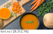 Купить «close up of vegetable pumpkin cream soup in bowl», видеоролик № 28312742, снято 8 апреля 2018 г. (c) Syda Productions / Фотобанк Лори