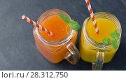 Купить «close up of fresh juices in mason jar glasses», видеоролик № 28312750, снято 8 апреля 2018 г. (c) Syda Productions / Фотобанк Лори