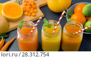 Купить «close up of fresh juices in mason jar glasses», видеоролик № 28312754, снято 8 апреля 2018 г. (c) Syda Productions / Фотобанк Лори