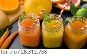 Купить «close up of fresh juices in mason jar glasses», видеоролик № 28312758, снято 8 апреля 2018 г. (c) Syda Productions / Фотобанк Лори