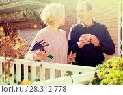 Купить «Elderly cuople talking at balcon», фото № 28312778, снято 16 октября 2018 г. (c) Яков Филимонов / Фотобанк Лори