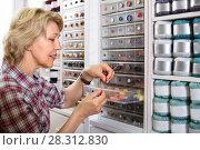 Купить «mature woman in sewing store», фото № 28312830, снято 23 мая 2019 г. (c) Яков Филимонов / Фотобанк Лори