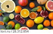 Купить «close up of citrus fruits on stone table», видеоролик № 28312854, снято 8 апреля 2018 г. (c) Syda Productions / Фотобанк Лори