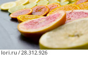 Купить «close up of grapefruit, orange, lemon and lime», видеоролик № 28312926, снято 10 апреля 2018 г. (c) Syda Productions / Фотобанк Лори