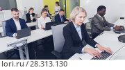 Купить «Senior businesswoman concentrated on work with laptop», фото № 28313130, снято 10 марта 2018 г. (c) Яков Филимонов / Фотобанк Лори