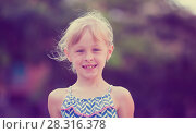 Купить «Closeup happy little girl», фото № 28316378, снято 20 июля 2017 г. (c) Яков Филимонов / Фотобанк Лори