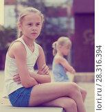 Купить «Small sisters upset after quarrel outside», фото № 28316394, снято 20 июля 2017 г. (c) Яков Филимонов / Фотобанк Лори