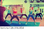 Купить «Training in a athletes with a boxing coach», фото № 28316854, снято 8 октября 2017 г. (c) Яков Филимонов / Фотобанк Лори