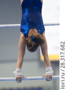 Купить «Athletic woman gymnasts performing exercises on the bar at the championship», фото № 28317682, снято 19 апреля 2018 г. (c) Константин Шишкин / Фотобанк Лори