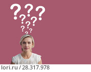 Купить «Woman with question marks emerging from head», фото № 28317978, снято 24 июня 2019 г. (c) Wavebreak Media / Фотобанк Лори