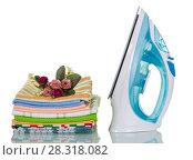 Купить «Electric iron and ironed stack of kitchen towels isolated on white», фото № 28318082, снято 14 марта 2016 г. (c) Сергей Молодиков / Фотобанк Лори