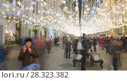 Купить «New Years celebration on Nikolskaya walking street in downtown rotation timelapse», видеоролик № 28323382, снято 16 января 2018 г. (c) Кирилл Трифонов / Фотобанк Лори