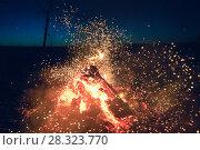 Купить «Fire at night against the dark sky», фото № 28323770, снято 13 апреля 2018 г. (c) Алексей Маринченко / Фотобанк Лори
