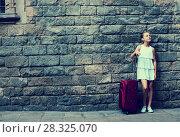Купить «girl in white with travelling bag», фото № 28325070, снято 17 августа 2017 г. (c) Яков Филимонов / Фотобанк Лори