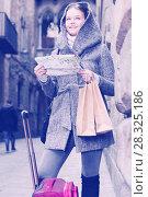 Купить «female with baggage in the city with map», фото № 28325186, снято 11 ноября 2017 г. (c) Яков Филимонов / Фотобанк Лори