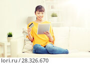 Купить «happy asian woman with tablet pc and credit card», фото № 28326670, снято 9 марта 2016 г. (c) Syda Productions / Фотобанк Лори