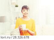 Купить «happy asian woman drinking from tea cup», фото № 28326678, снято 9 марта 2016 г. (c) Syda Productions / Фотобанк Лори