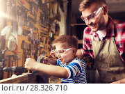 Купить «father and son with plane shaving wood at workshop», фото № 28326710, снято 14 мая 2016 г. (c) Syda Productions / Фотобанк Лори